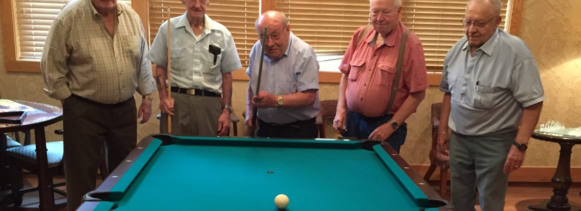 Eventide Sheyenne Crossings - Residents playing pool