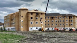 Apartments are prepped for siding and stone, and roofing in nearing completion.